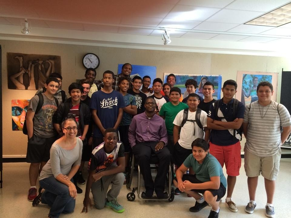 Thomas Cousins with a 9th grade class at Albert Einstein High School.