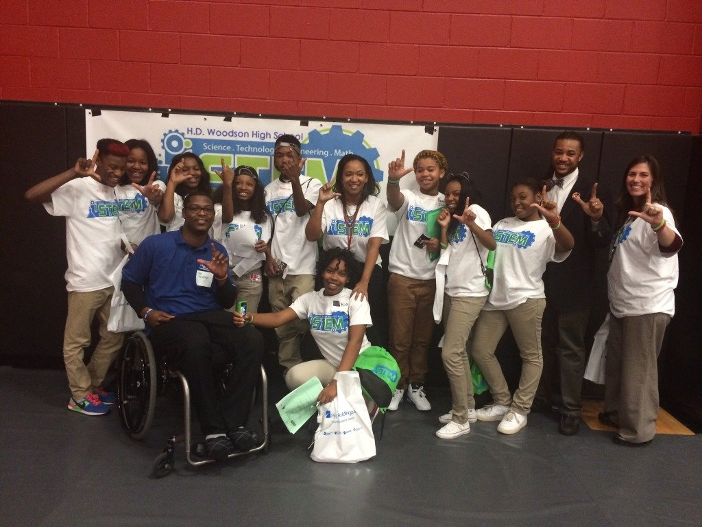 """""""L"""" for Leadership. iSTEM academy participants with Tipper and colleague Kendrick Tilgman."""